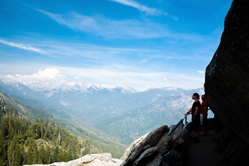 Tourists looking at snowcapped mountains, Sequoia National Park, California