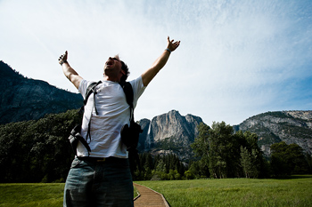 Hiker standing with arms raised, Yosemite National Park, California