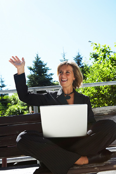 Businesswoman using laptop computer outdoors