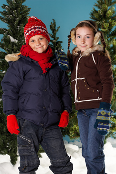 Boy and girl posing in winter outerwear