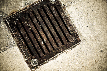Close-up of drain on pavement