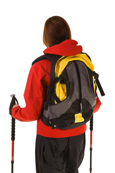 Back view of woman hiker in winter outerwear