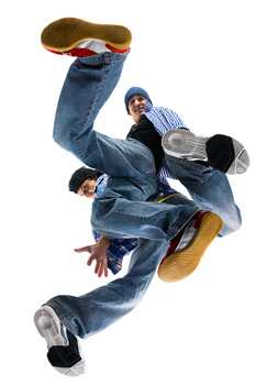 Low angle view of two young men break dancing