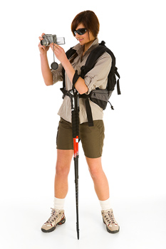 Woman hiker with digital camera