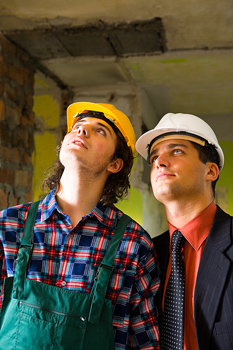 Foreman and construction worker at site