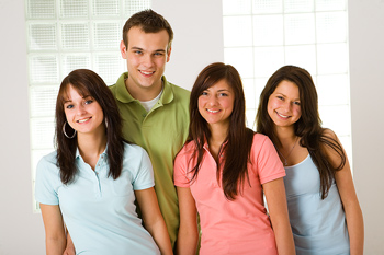Four teenagers posing together