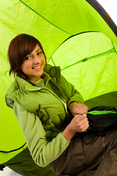 Studio shot of smiling woman inside tent