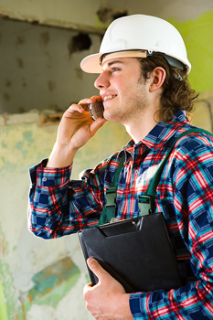 Portrait of construction worker on cell phone