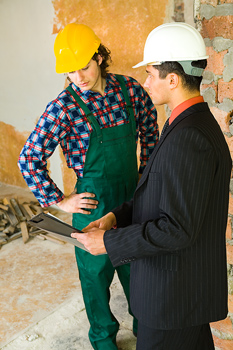 Foreman giving instructions to worker at construction site