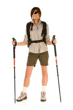Portrait of woman hiker with walking sticks