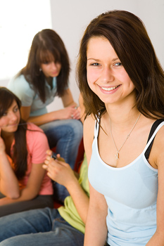 Smiling teenage girl posing with others