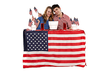 Smiling couple posing with American flags