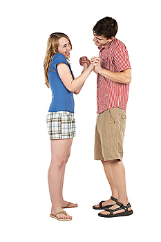 Playful couple holding hands