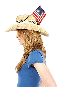 American flag in woman's straw hat