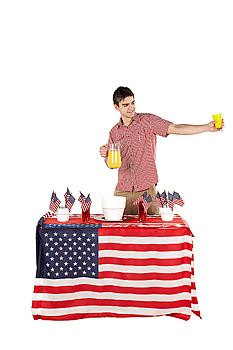Man with pitcher of lemonade on the Fourth of July