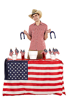 Man posing with horseshoes on Fourth of July