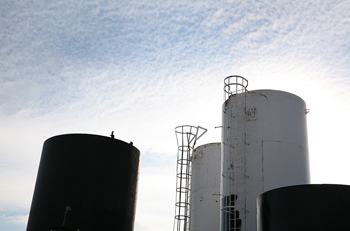 Industrial storage tanks with ladders