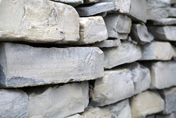 Stone slabs stacked in layers