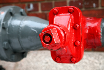 Industrial pipe valve painted red