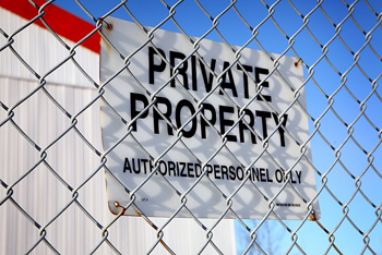 Sign on fence declaring private property