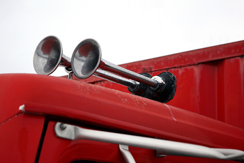 Pair of horns on exterior of vehicle