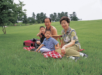 Grandparents with grandsons in park