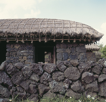 Rustic stone shelter with thatched roof