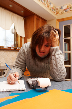 Woman agonizing over budget