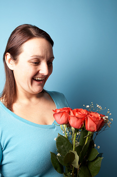 Studio shot of smiling woman with bouquet
