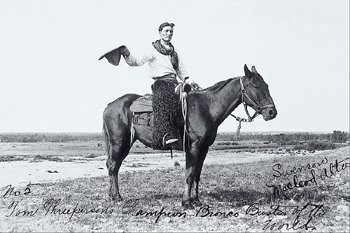 Champion bronco buster on horse