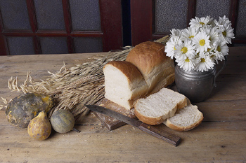 Homemade loaf of bread by ingredients