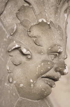 Weathered plaster sculpture of face