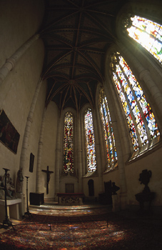 Fisheye view of cathedral interior with stained glass windows