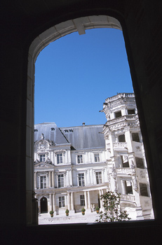 View of mansion exterior through a window