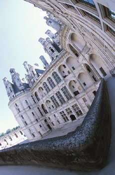 Fisheye view of baroque castle facade with courtyard