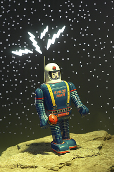 Toy astronaut standing on a rock