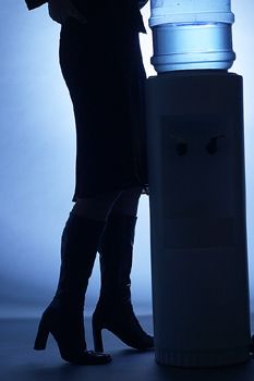 Mysterious woman by office water cooler