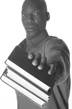 Man posing with books
