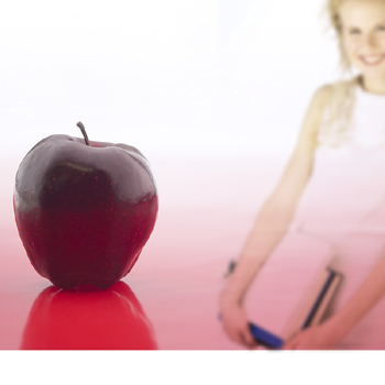 Young woman and an apple