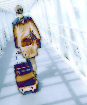 Rear view of businesswoman walking in airport terminal