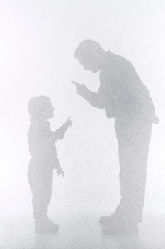 Silhouette of man and boy