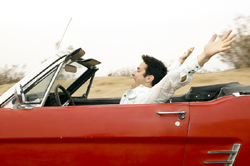 Carefree man in convertible
