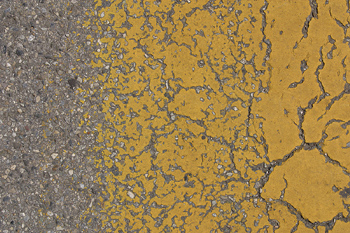 Chipped paint on pavement
