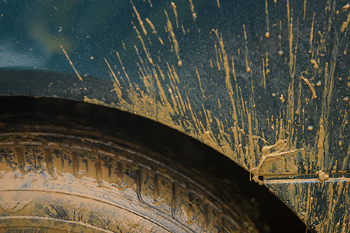 Close-up of mud on wheel of car