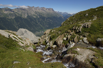 Rocks and stream on mountain, Alps, France