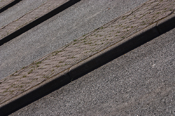 Close-up of curb and road