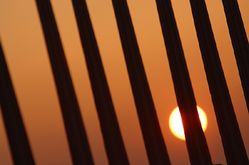 Sunset behind bars