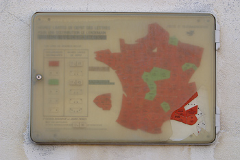 Weathered map sign in France