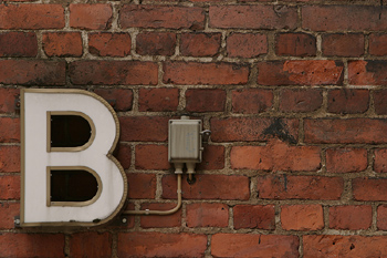 Letter B on brick wall