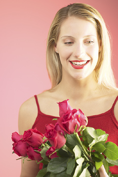 Woman with bouquet of Valentine's Day roses